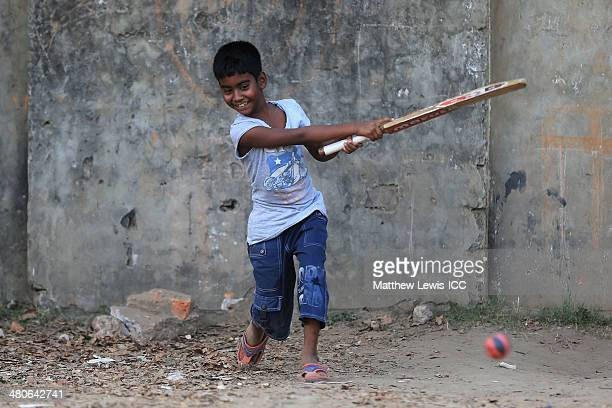 A local child plays cricket on March 26 2014 in Dhaka Bangladesh