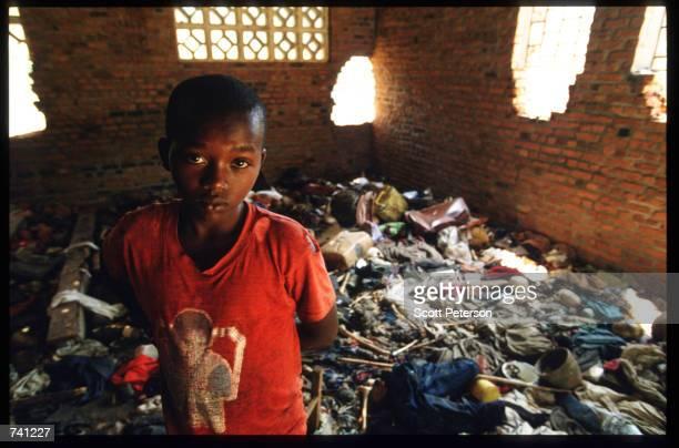 A local child stands amid the debris September 16 1994 at a church in Ntarama Rwanda The bodies of four hundred Tutsis murdered by Hutu militiamen...