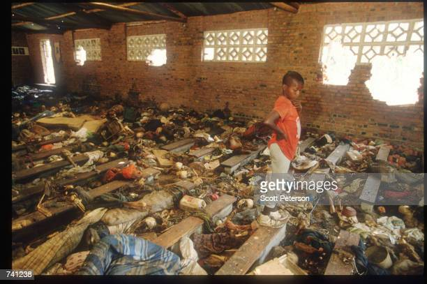 A local child stands amid the destruction September 16 1994 at a church in Ntarama Rwanda The bodies of four hundred Tutsis murdered by Hutu...