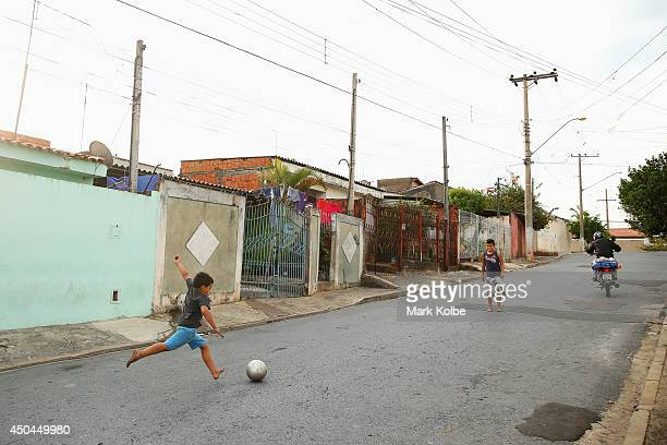 Local children are seen playing football on the street on June 10 2014 in Itu Brazil