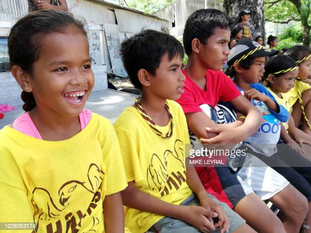 Local children attend a game of Australian Rules football in Aiwo on the Pacific island of Nauru on September 1 2018 Official talks at the 18nation...
