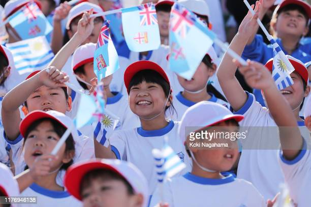 Local children cheer with both Fiji and Uruguay flags prior to the Rugby World Cup 2019 Group D game between Fiji and Uruguay at Kamaishi Recovery...