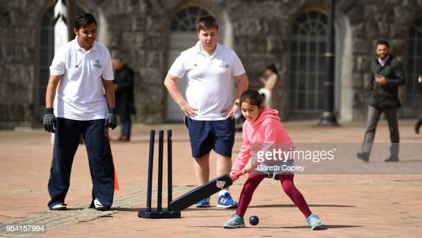 Local children play alongside Cricketeers in a game of street cricket during the Cricket World Cup 2019 Volunteers Launch event at Victoria Square on...