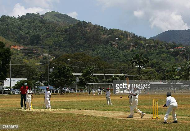 Local children play cricket on the Savannah on March 18 2007 in Port of Spain Trinidad