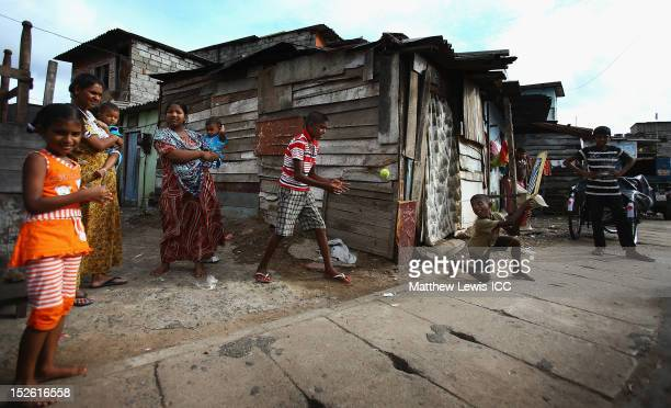 Local children play cricket on the streets outside the R. Premadasa Stadium ahead of the ICC World Twenty20 2012 Group A match between England and...