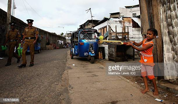Local children play cricket on the streets outside the R Premadasa Stadium ahead of the ICC World Twenty20 2012 Group A match between England and...