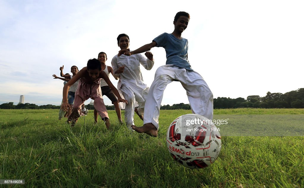 Local children play football in a park ahead of the FIFA U-17 World Cup India 2017 tournament on October 5, 2017 in Kolkata, India.