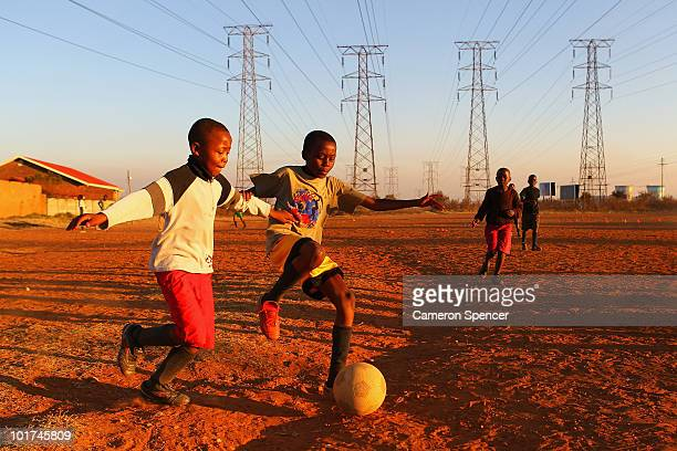 Local children play football on dirt pitches in a Soweto township on June 7 2010 in Johannesburg South Africa The 2010 FIFA World Cup kicks off in...