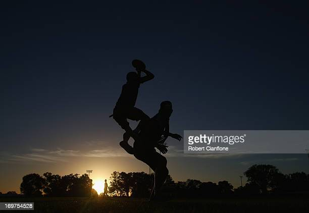 Local children play football prior to the round ten AFL match between the Western Bulldogs and Port Adelaide Power at TIO Stadium on June 1, 2013 in...