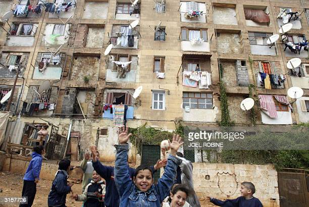 Local children play in front of rundown tenement apartments in the poor neighborhood of El Harrach Baraki east of the capital city of Algiers 26...