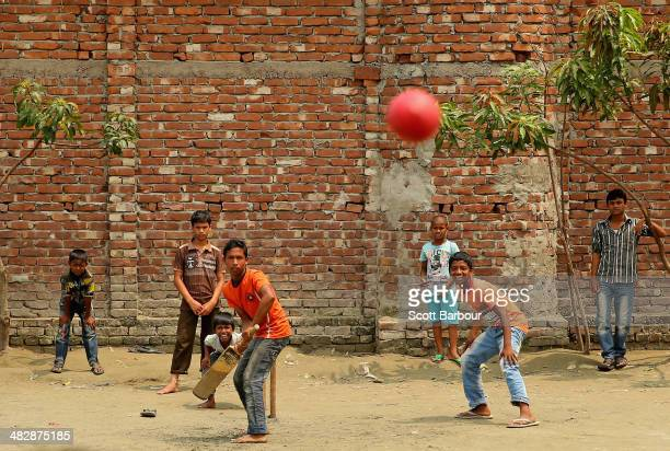 Local children play street cricket in the suburbs of Dhaka ahead of the India and Sri Lanka Final during the ICC World Twenty20 Bangladesh 2014 on...