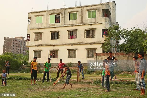 Local children play street cricket in the suburbs of Dhaka during the ICC World Twenty20 Bangladesh 2014 on March 27 2014 in Dhaka Bangladesh