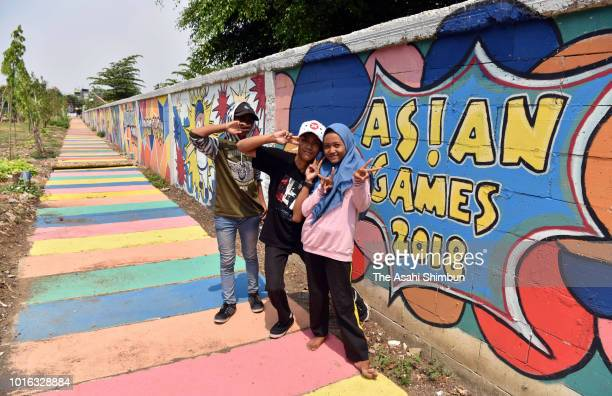 Local children pose for photographs ahead of the Asian Games on August 12 2018 in Jakarta Indonesia