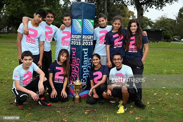Local children pose with the Webb Ellis Cup after a coaching session with Lawrence Dallaglio around the newly installed posts at Inwood Park during...