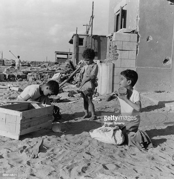 Local children scavenge for food amongst the ruins of their city during the Suez Crisis 15th November 1956