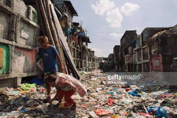 CEMETERY MANILA PHILIPPINES Local children seen at the slum in the cemetery In the center of Pasay District of Metro Manila is a cemetery where over...