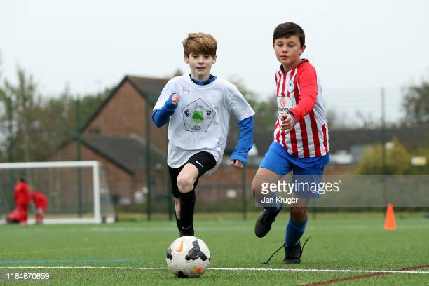 Local children take part in activities during a Premier League Football Foundation Hub Opening at Jericho Lane Playing Fields on October 31, 2019 in...