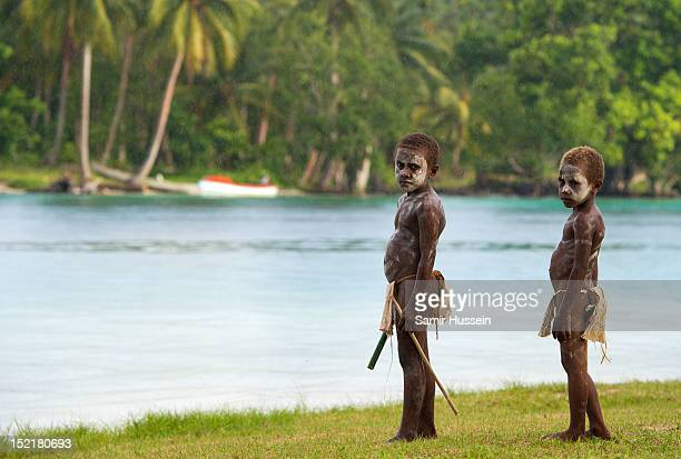 Local children wait to welcome Catherine Duchess of Cambridge and Prince William Duke of Cambridge as they visit Tuvanipupu Island on their Diamond...