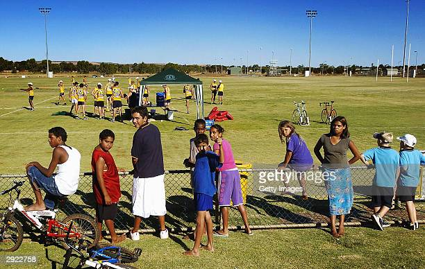 Local children watch the West Coast Eagles as they get ready for their first training session at the Oasis Oval in the Eastern Goldfields town of...