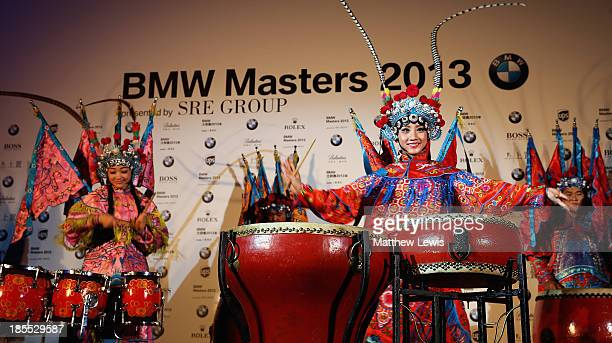 Local Chinese drummers pictured during a press conference ahead of the BMW Masters 2013 Tournament at the Mandarin Oriental Hotel Pudong on October...