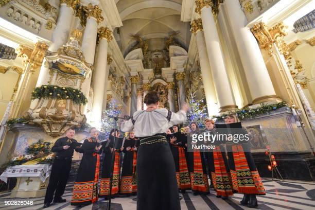 A local choir perform during the Festival 'Velyka Koliada' inside the former Dominican church and monastery in Lviv More than 70 different groups...