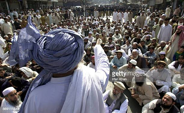 A local cleric Maulana Samiullah addresses a pro–Taliban rally held to protest against the session of two day meeting of Assembly for Peace and...