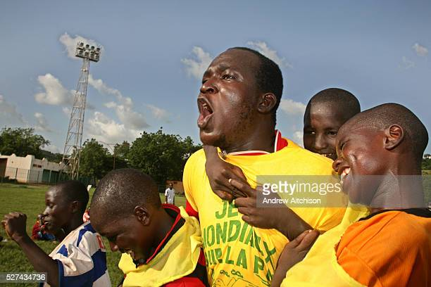 Local coach Youba Cisse celebrates with the kids on his team after winning the Coaching for Hope tournament in Bamako Mali Coaching for Hope is a...