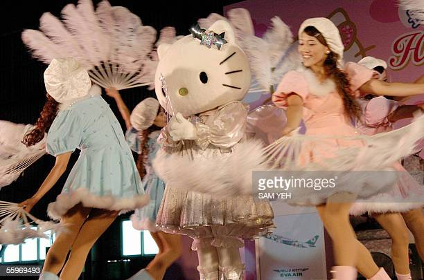 Local dancers perform with Hello Kitty character at a press conference at Taoyuan EVA Air hangar 20 October 2005 to promote Hello Kitty decorated...