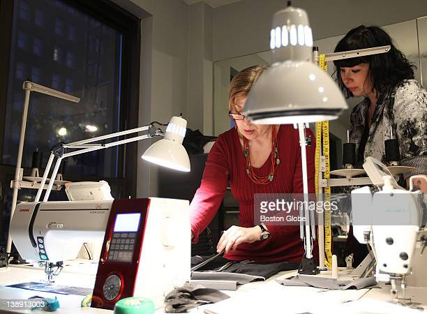 Local designer Jackie FraserSwan discusses details on a design with her head seamstress Lana Denis at Swan's Newbury Street atelier on Feb 2 2012 She...