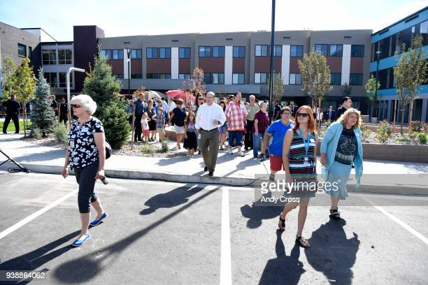 Local dignitaries along with Mental Health Center of Denver officials and local area preschoolers arrive for a ribboncutting ceremony for Sanderson...