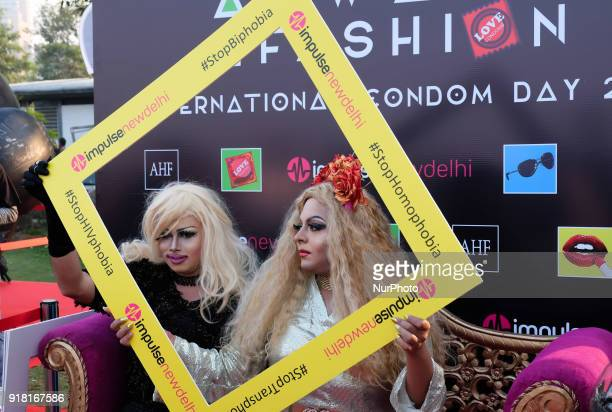 Local drag artists pose at the selfie booth during an event to mark International Condom Day in New Delhi on February 13, 2018. The event was...
