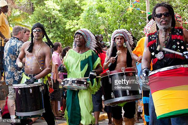 local drummers playing on their instruments at st.john festival, usvi - steel drum stock photos and pictures