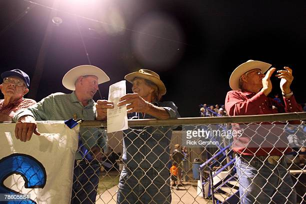 Local famers socialize at the six man football matchup between the Rule Bobcats and the Throckmorton Greyhounds on October 12 2007 in Rule Texas In...