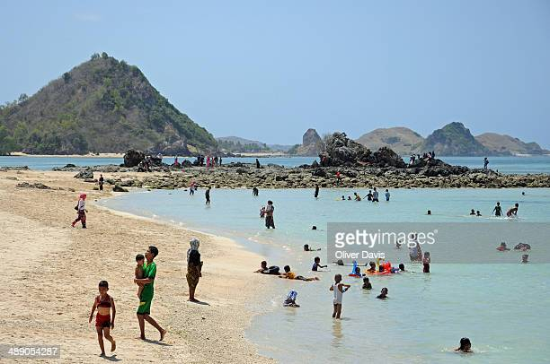 CONTENT] Local families enjoying day at Kuta Beach Southern Lombok