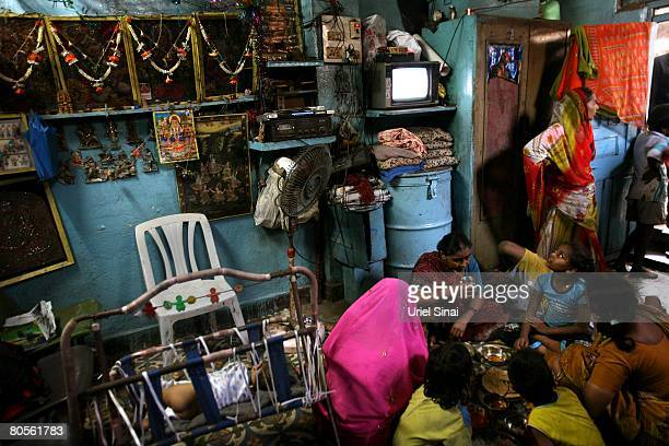 A local family eat at their one room home at the Dharavi slum said to be 'Asia's largest slum' April 2008 in Mumbai India A city redevelopment...