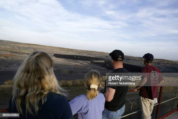 A local family stops at a mine overview in Gillette Wyoming May 5 2004 Wyoming coal is transported by rail east to St Louis Detroit Chicago and...
