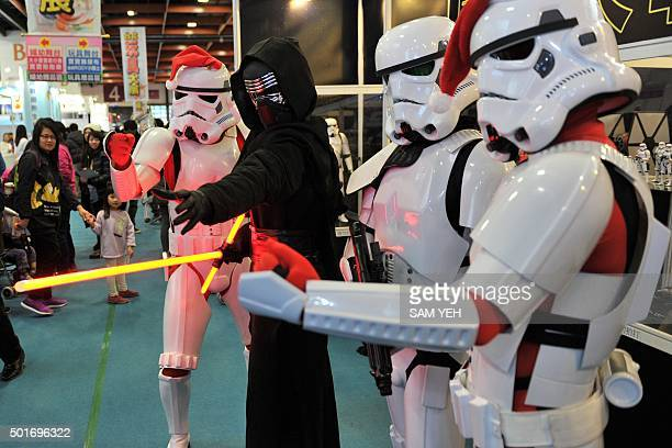 Local fans dressed as Star Wars character Kylo Ren and Stormtroopers pose during a toy exhibition in Taipei on December 17 2015 Ever since 1977 when...