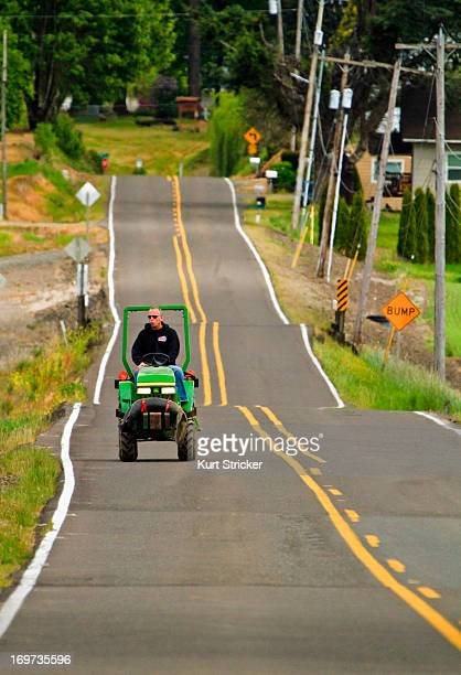 CONTENT] A local farmer enjoys the morning commute via tractor on a rural country road in Skunkville Oregon Skunkville is in the middle of the...