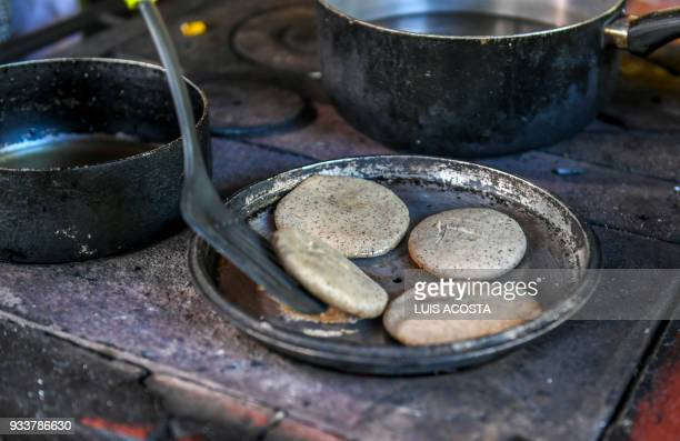 Local farmers learn how to prepare 'arepas' using dried seeds powder of the Guaimaro tree during a workshop in Dibulla La Guajira department Colombia...