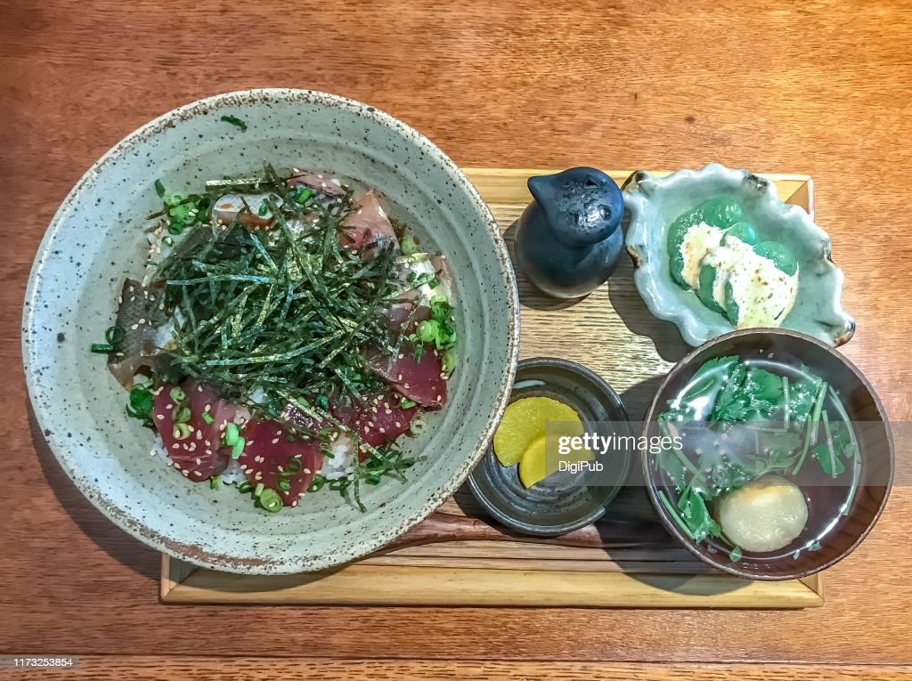 Local fish of three kinds zuke donburi lunch meal served at Japanese bar restaurant : Stock Photo