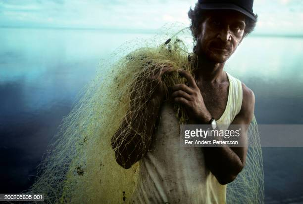 Local fisherman arrives back from the sea with his net on April 27, 1997 on Bora Bora, French Polynesia. The Island is a playground for rich tourists...