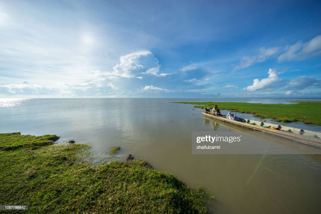 Local fisherman at lake Thale Noi become a part time tourist guide  to travel area surrounding. : Stock Photo