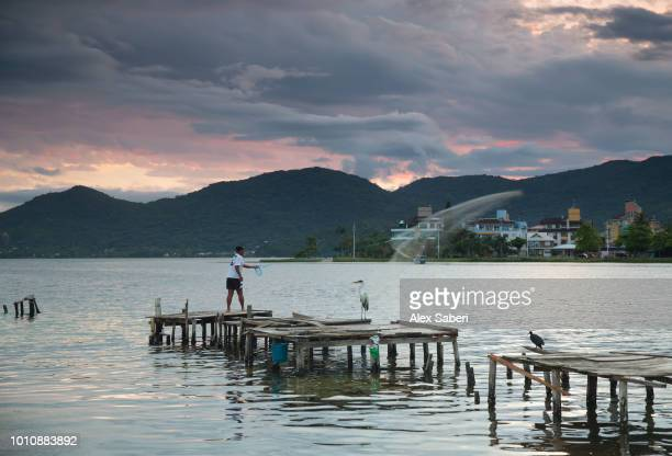 A local fisherman fishing at Lagoa da Conceicao lake on Florianopolis island