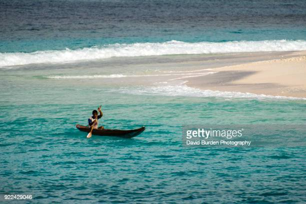 Local fisherman in Dugout Wooden Canoe