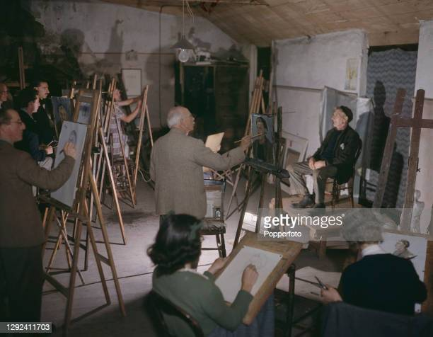 Local fisherman Jimmy Stevens, sitting as an artist's model, poses for of students of the St Ives Society of Painting to paint and draw in a studio...