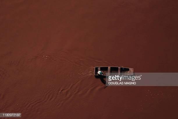 Local fisherman Jose Geraldo dos Santos sails the Paraopeba river in his canoe in Juatuba Minas Gerais state Brazil on March 18 where a retention...