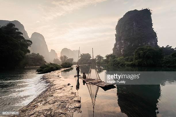 local fisherman punting along Yulong river