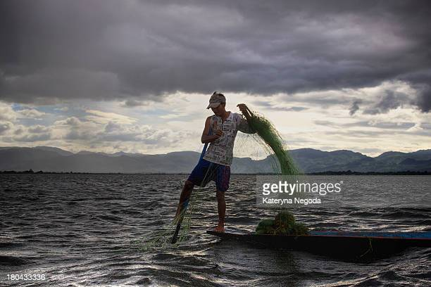 Local fishermen are known for practicing a distinctive rowing style which involves standing at the stern on one leg and wrapping the other leg around...