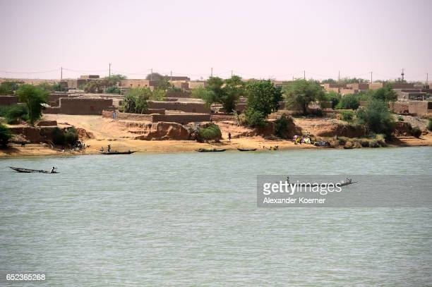 Local fishermen are seen on the river Niger on March 7 2017 in Gao Mali Each week locals and Touareg nomads gather at the market to trade their...