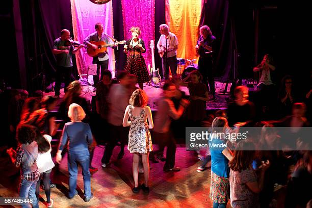 Local folk ban The Muckers perform as revelers enjoy an evening of line dancing at a 'Chill Out Ceilidh' held at Chats Palace an arts and community...